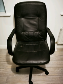 Office Chair. Swivels 360 degrees & can be raised up and lowered.