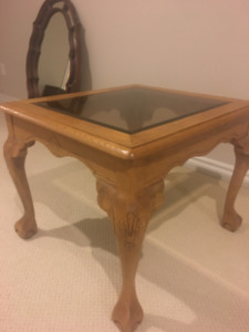 Solid wood side table, glass surface.