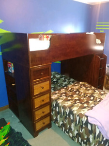 Bunkbed with desk and shelves