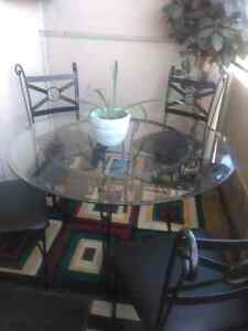 Circular Glass dining table ( 4 chairs)
