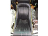 Two vgc bucket seat and two full harness seat belts
