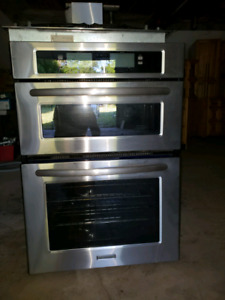KitchenAid built in owen and microwave gas cooctop and hood fan.