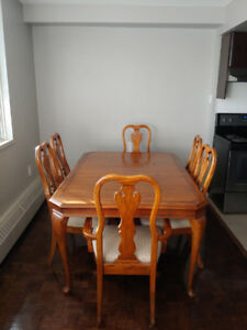 Wooden dining table + 6 chairs + 2 leaflets