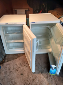 Under counter american refrigerator. And matching freezer