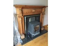 Cast iron fireplace with wooden surround and black granite hearth