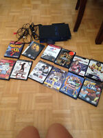 Playstation 2 with games and controlers