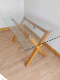 Glass dining table 6 foot by 3 foot seats 6 comfortably 8 with ends