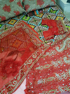 Red indian bridal lehenga with set and bangles