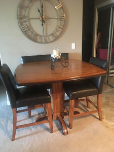 Bar Table pedastal with 5 leather chairs and two leather benches