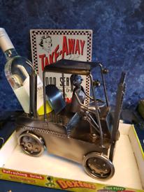 Bottle holder met artworks forklift truck
