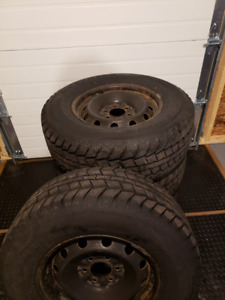 Four LT265/70R17 10PR Load Range Winter Tires & Rims