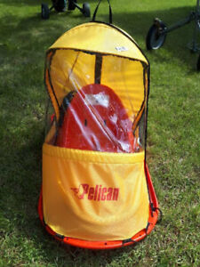 Pelican baby sled with cover