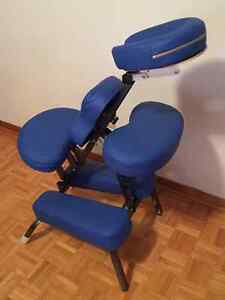 Portable massage chair with carrying case.
