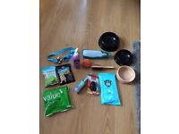 Unused dog puppy bowls, treats, brush, toys and accessories