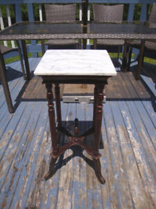 Vintage Marble Top Side Table 29 inch tall x 14 inch wide.