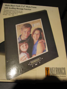 BNIB photo frame with scrolling message function.