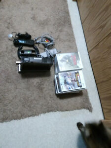 Wii and almost 20 games, controller, and nunchuck