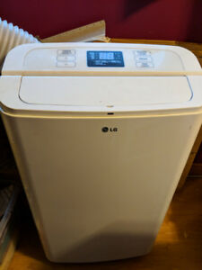 LG Standing Air Conditioner with remote control & window exhaust