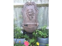 Gentle lion hanging water feature