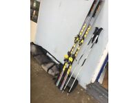 Fischer Revolution 180cm skis and poles and flight bag