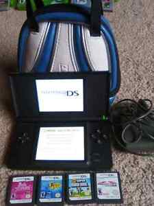 Nintendo DS Lite with charger,4 games and carrying case