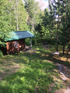 1 Acre Lake Front Lot With Small Cottage