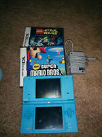 Nintendo dsi with charger and 2 games