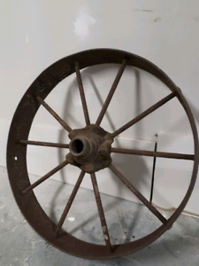 Antique wagon wheel.cast Iron beautiful rusty petina .