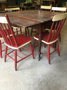 Expansive Antique Drop-leaf table with six wooden chairs
