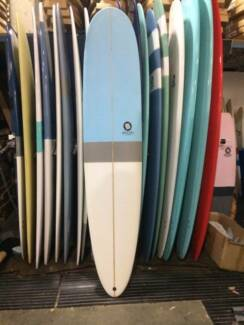 Surfboard Longboard w leash fins etc.  BRAND NEW IN PACKAGE