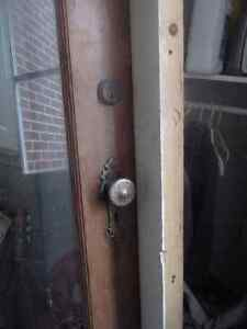 old fashioned solid door, with frame and hardware