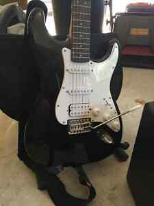 E-Guitar with Stand, Carrying Bag, Amplifier & iRig