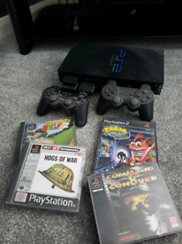 PS2+2 CONTROLLERS & GAMES