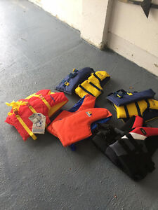 life jackets -one with a tag on never been used