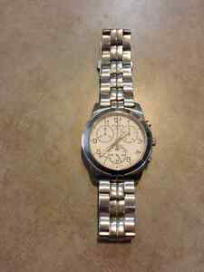 Tissot silver men's watch for sale.