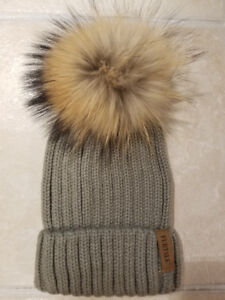 3458de1cec9 Winter knitted woman hat with real fur pompom