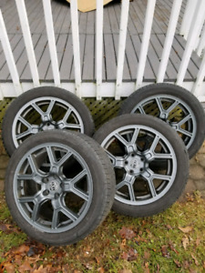 Set of 4 summer tires on rims.