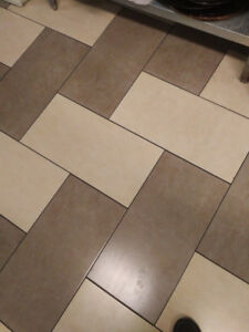 """340 sq ft of 12""""x24"""" porcelain tile brown and cream colour"""