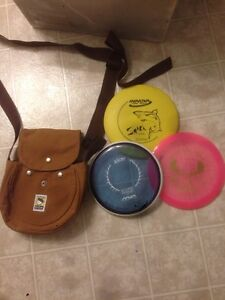Disc golfs discs and carrying bag