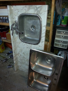One single sink, one double sink and 54 inch counter top