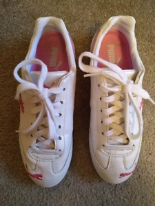 Pink & white puma running shoes
