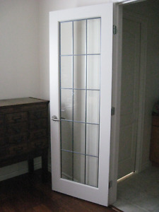 Pretty interior door w.  15 lite glass insert