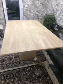 Stone dining table with a matching varse