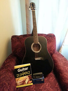 Acoustic guitar with electric tuner bag and book