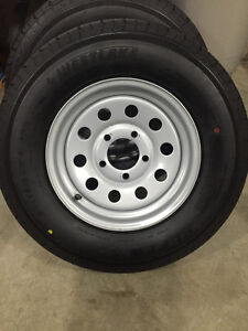 Brand new ST175/80R13 trailer tires and rims.
