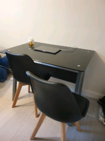 Desk and two chairs