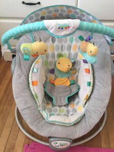 Bouncing, vibrating, musical baby chair