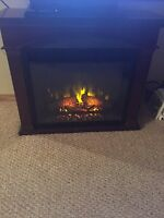 Electric fireplace heater with settings .