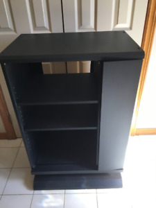 Black TV stand or shelving unit on wheels