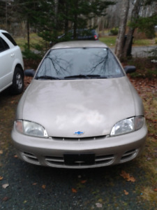 2002 Chevrolet Cavalier, 4 extra rims, and 2 new all-seasons